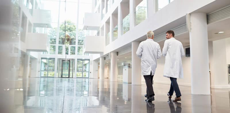 doctors walking in hospital corridor