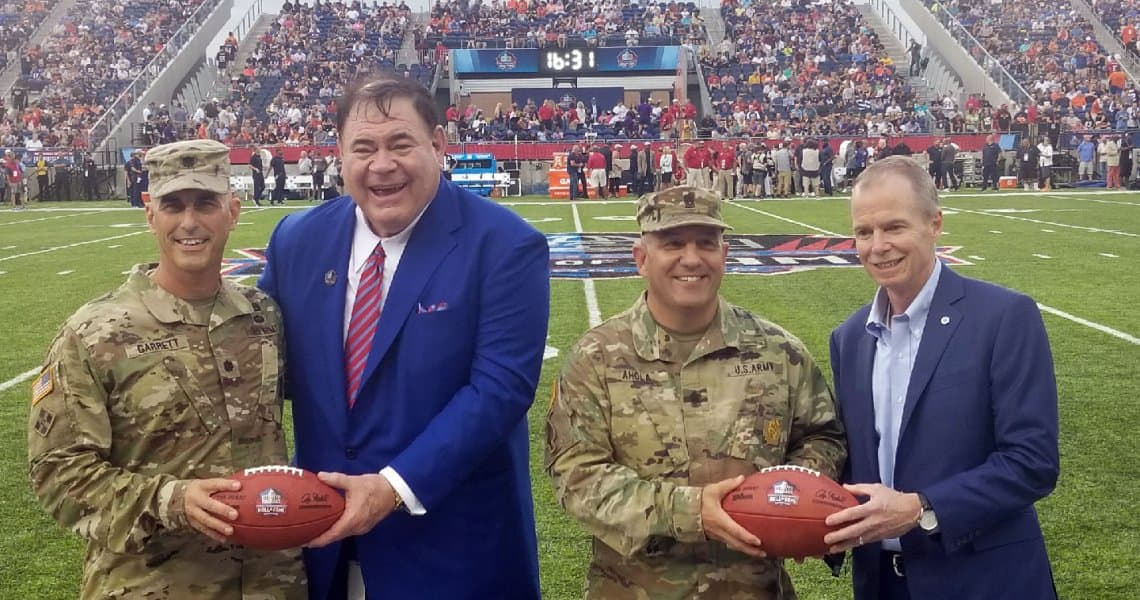 Johnson Controls Chairman and CEO George Oliver (pictured at far right) joined Pro Football Hall of Fame President David Baker (second from left) in honoring U.S. military members during pregame ceremonies for the Hall of Fame Game on Aug. 2, 2018. The game is part of Enshrinement Week Powered by Johnson Controls.