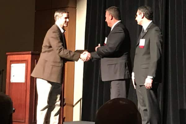 Mike Richardson, plant manager, unitary products group, Johnson Controls, and Steve Tice, vice president of engineering, unitary products group, Johnson Controls, accept the Manufacturing, Wholesale & Distribution award from the Wichita Business Journal.