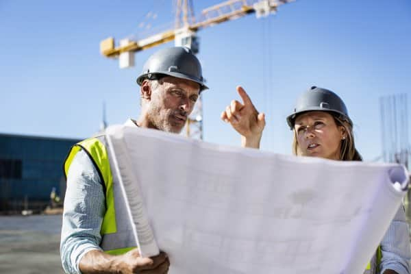 construction crew discussing over blueprint